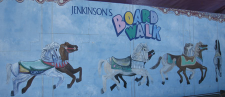 painting on a wall advertising the boardwalk