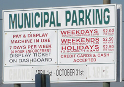 parking sign in town municipal parking lot